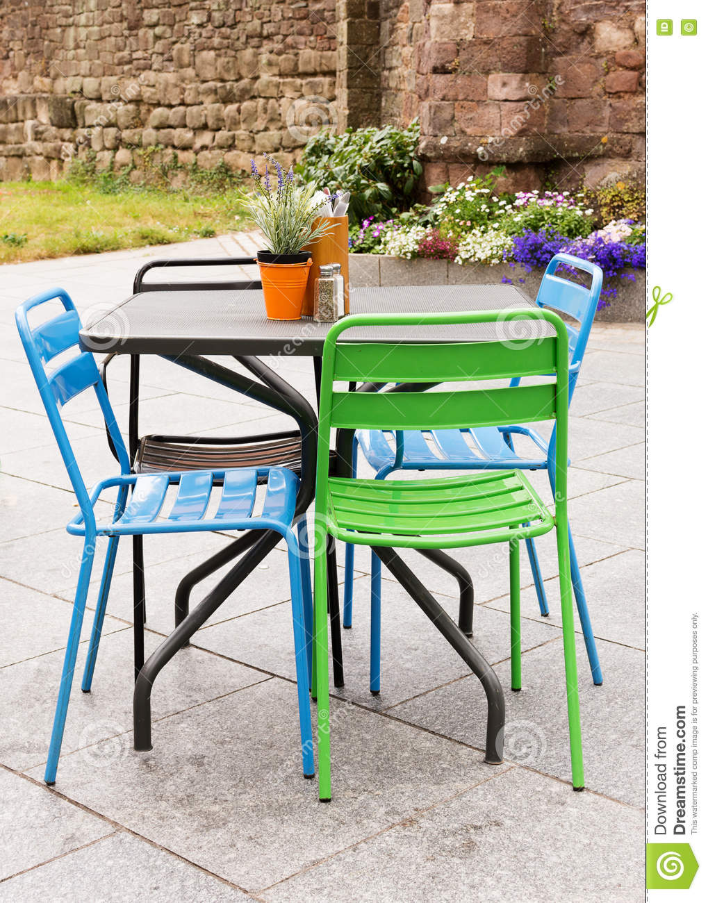 Garden Table And Chair On Patio Stock Image - Image of decor