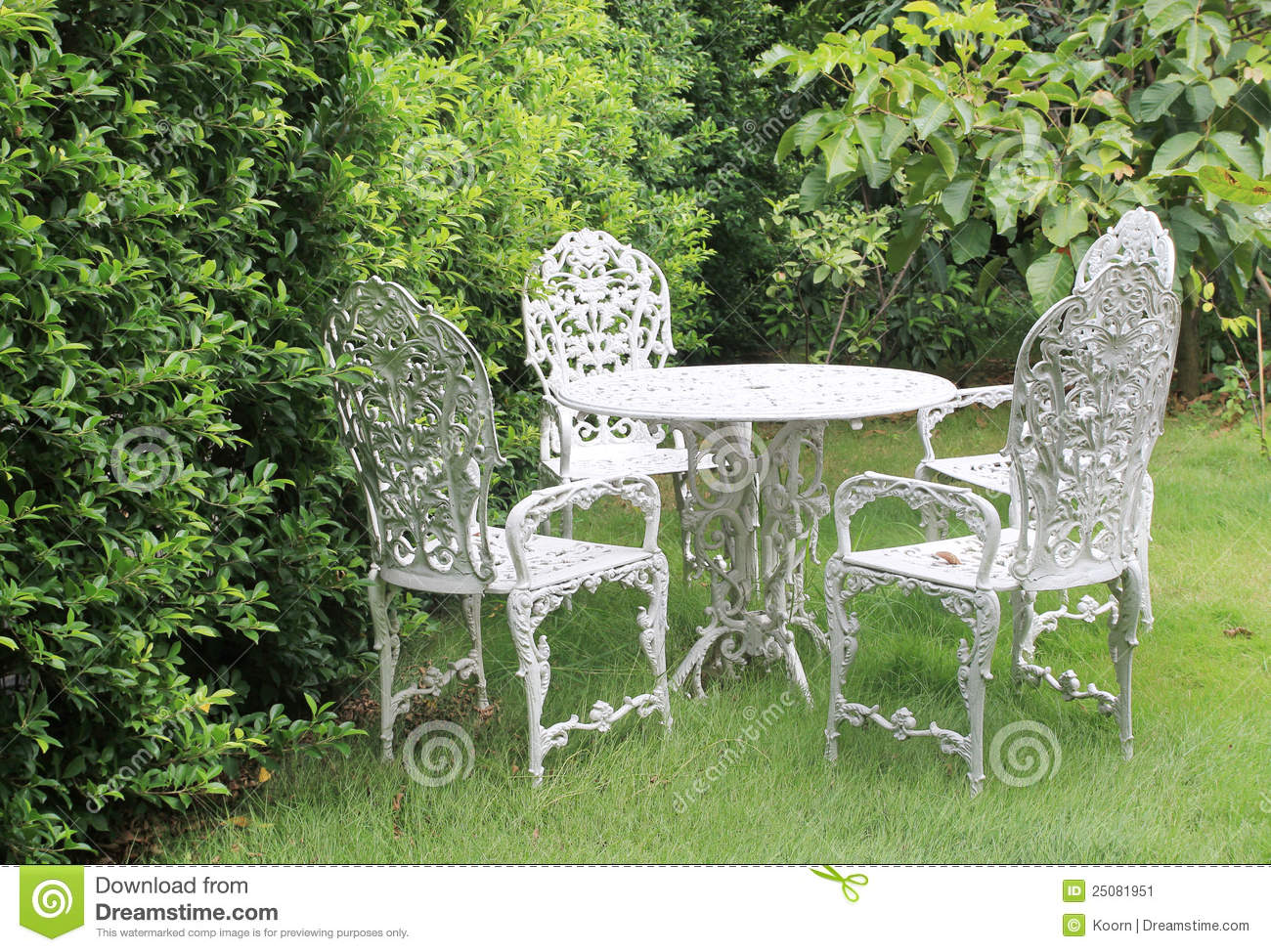 White metal garden chairs - Garden Table And Chairs Stock Image