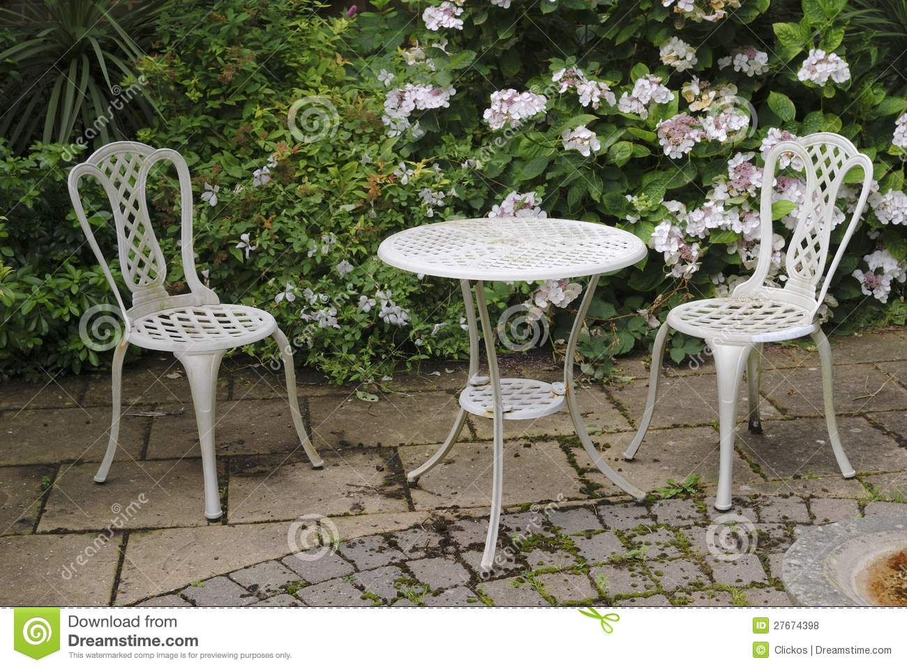 Garden table and chairs stock photo image of paving 27674398 - Garden furniture table and chairs ...