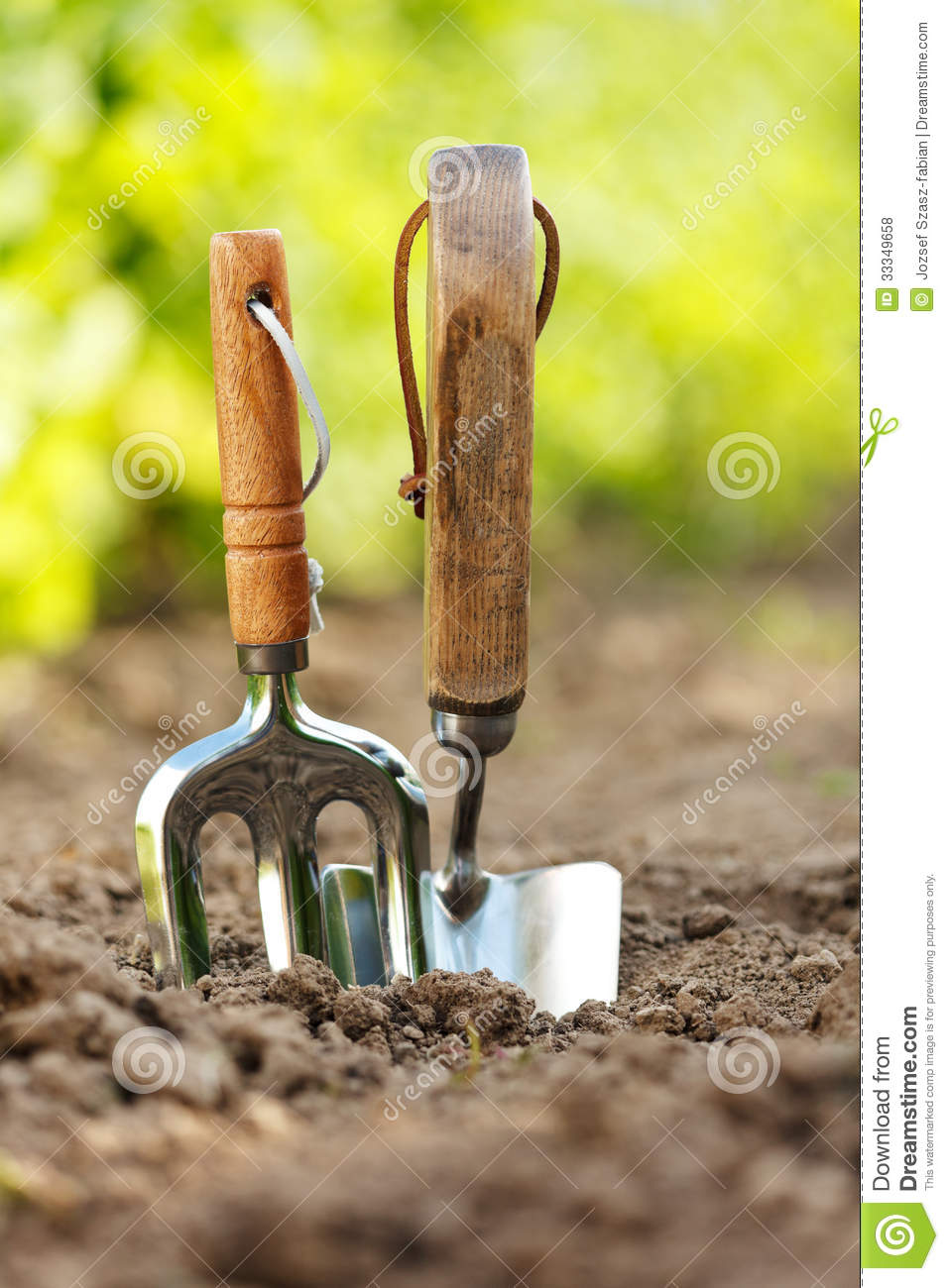 Garden tools stuck in soil royalty free stock photos for Soil utensils