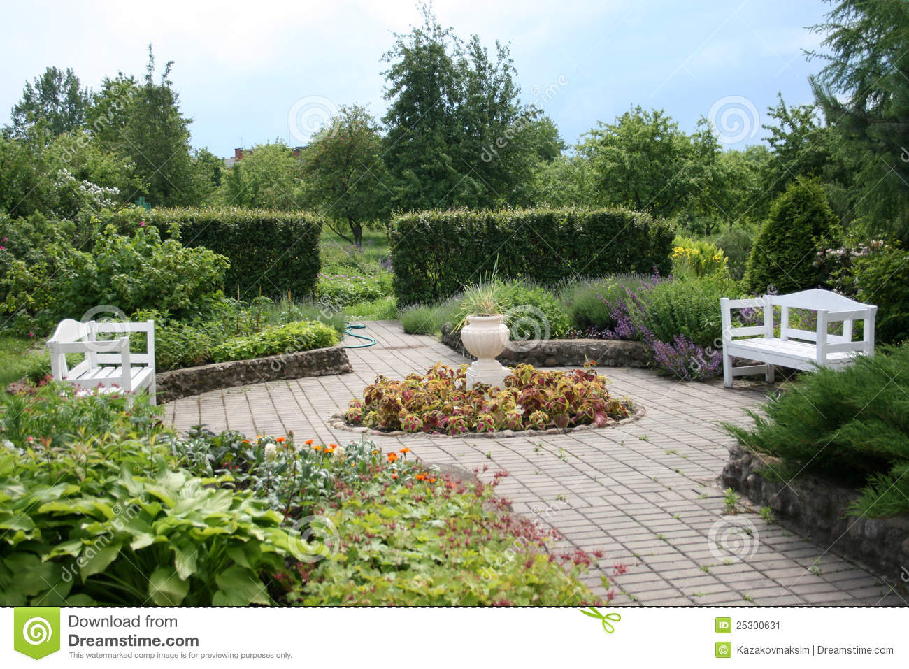 Garden with two white benches