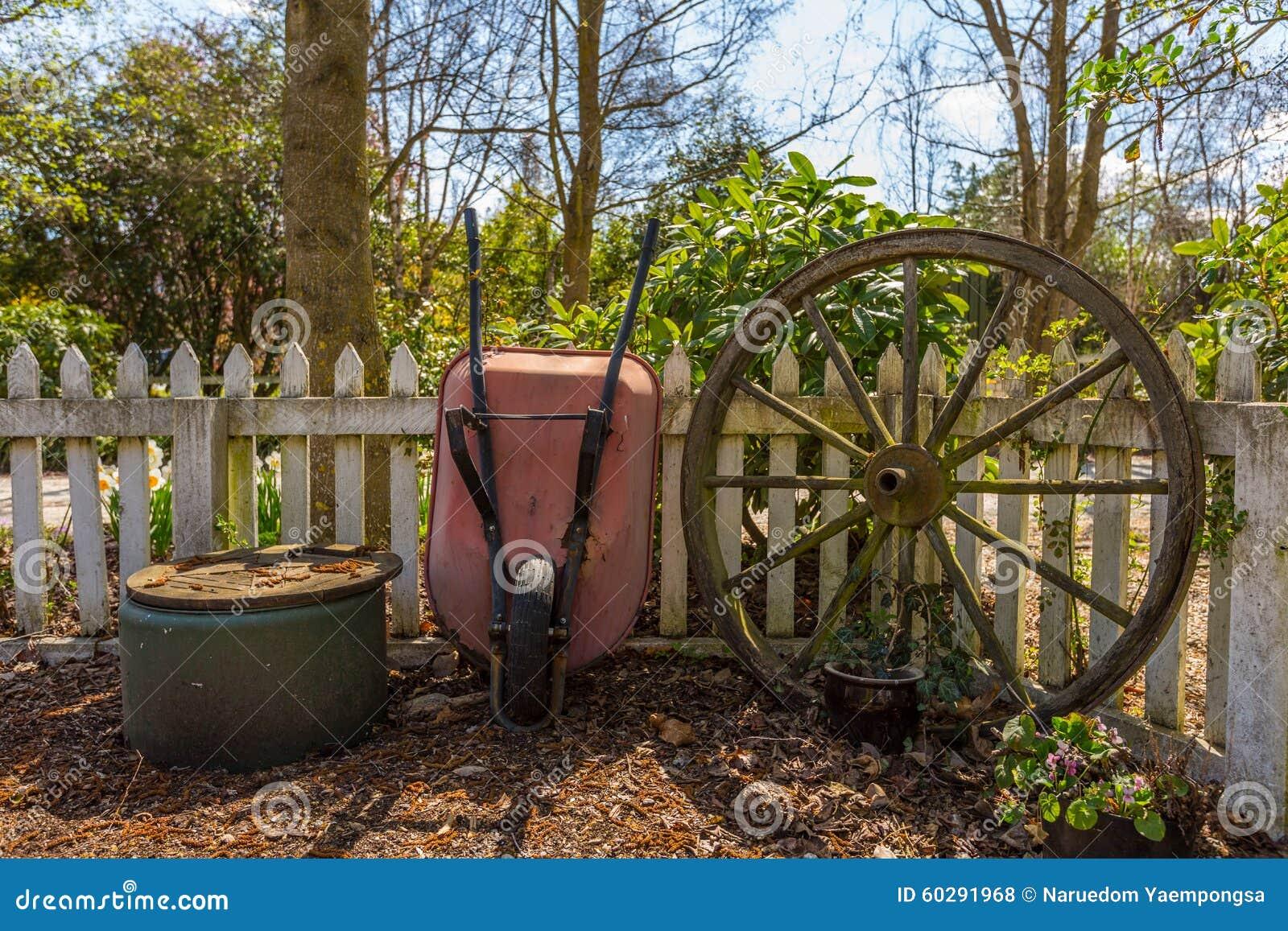 Garden Wheelbarrow And And Old Bullock Cart Wheel Stock Photo ...