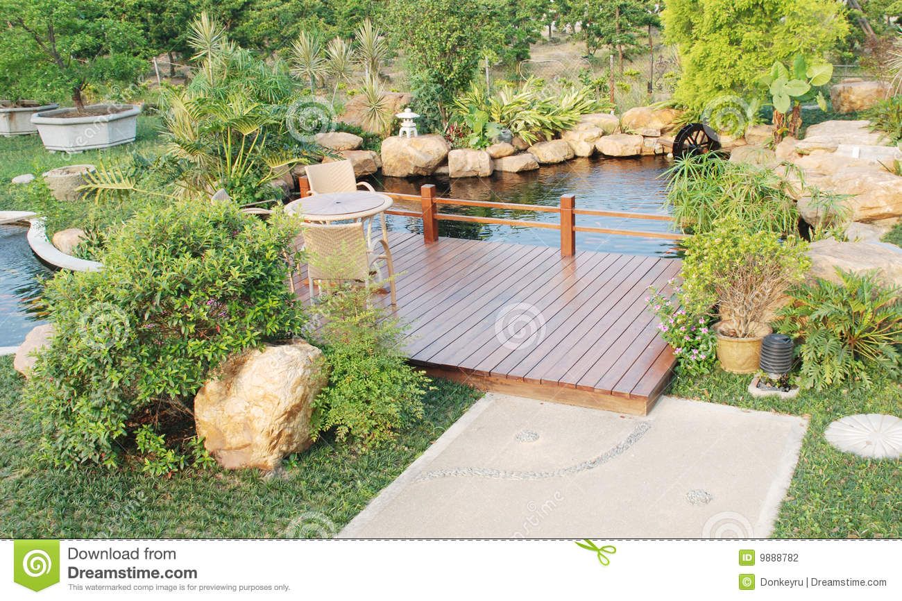 Garden with wood pergola and pond stock photography for Garden table fish pond