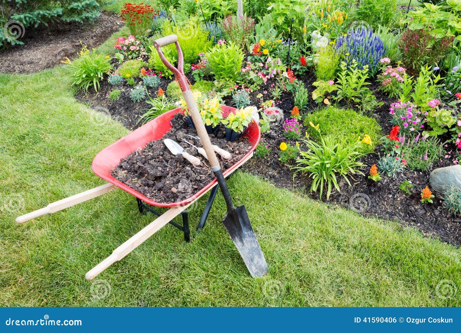 Garden work being done landscaping a flowerbed stock photo for Topsoil garden soil