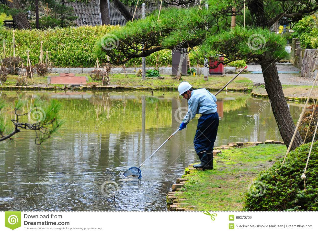 Garden worker editorial stock image image of hakusan for Garden pond cleaning