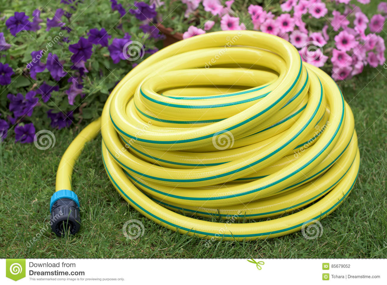 Garden yellow plastic hose-pipe