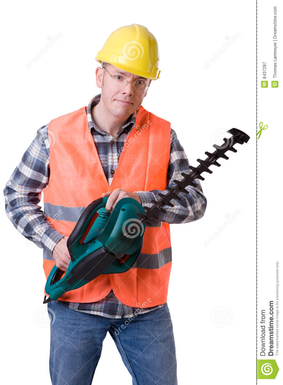Gardener with hedge trimmer