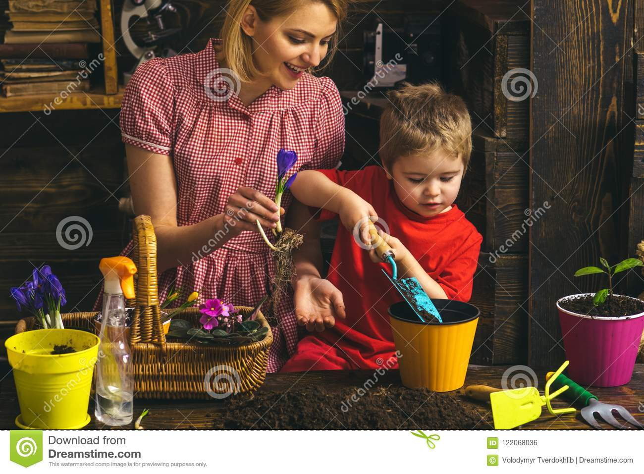 Gardening concept. Little child help mother planting flower in pot with gardening tool. Organic gardening. Gardening is