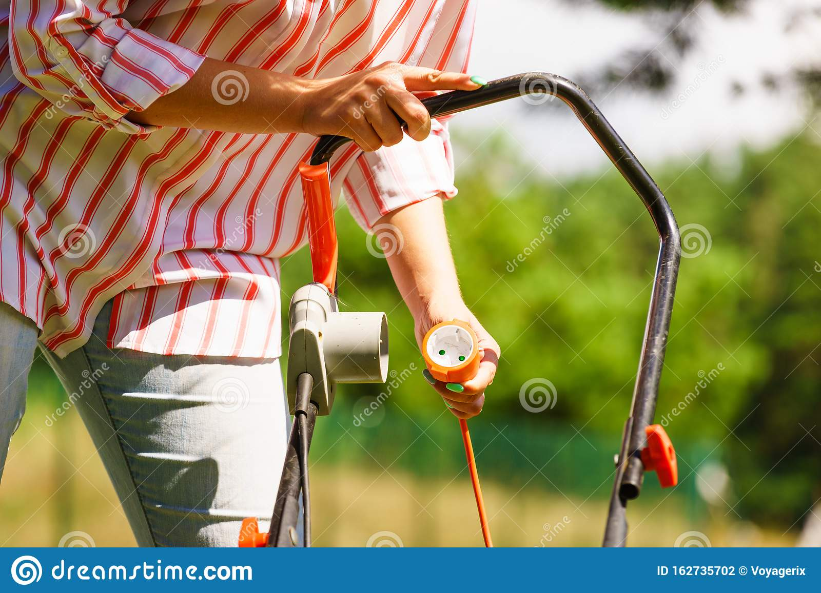 Senior Woman Mowing Grass Stock Photo - Download Image Now