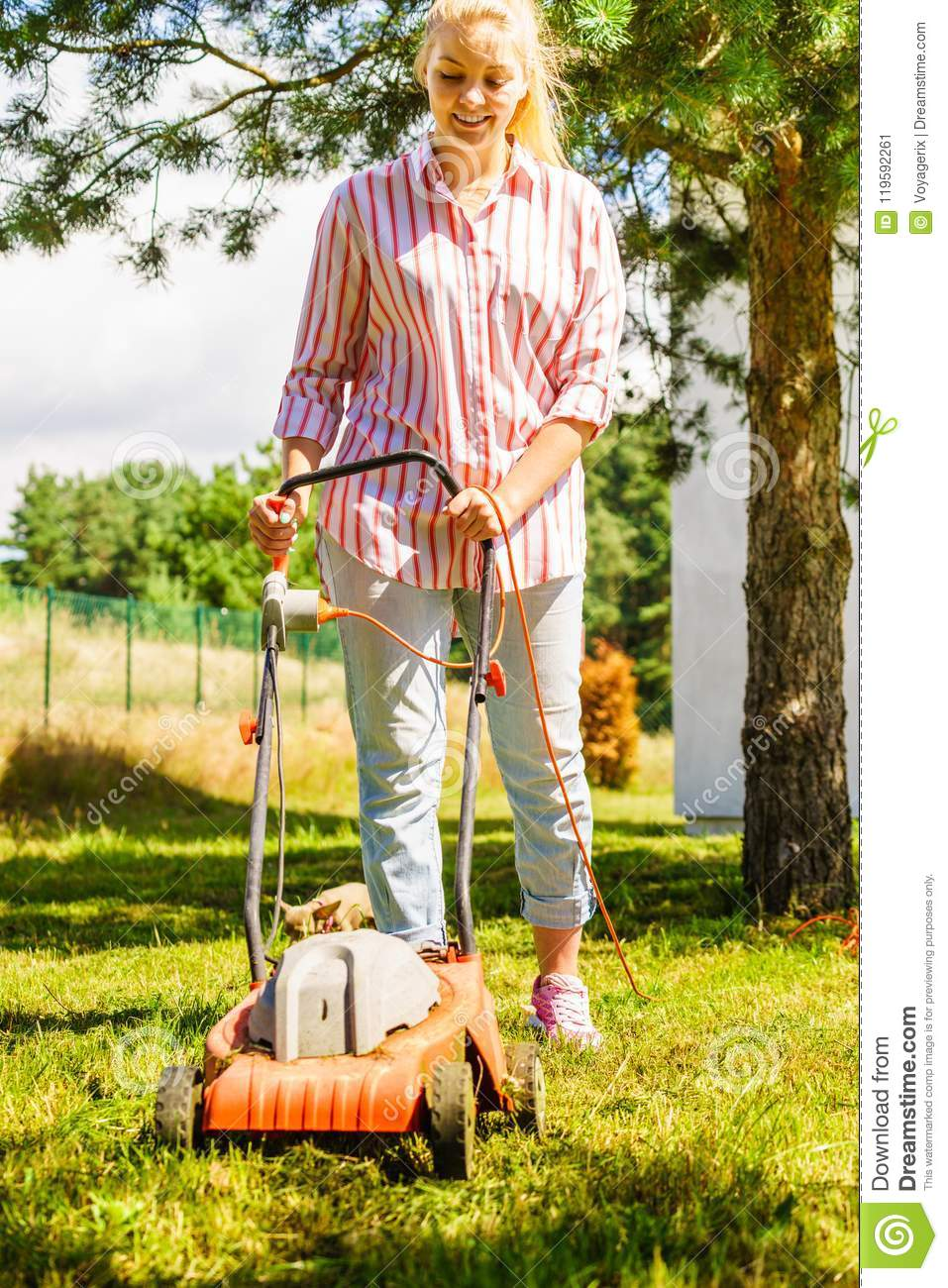 Woman Gardener Mowing The Grass With Lawn Mower Stock