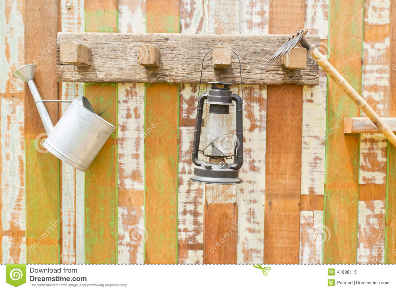 Gardening tools hanging on wooden wall