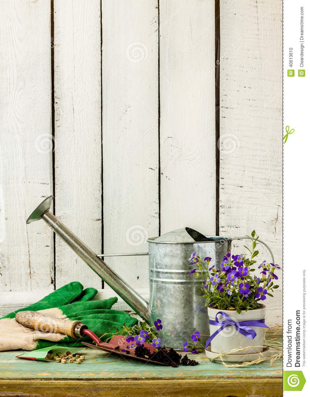 Gardening tools on white wood background - spring