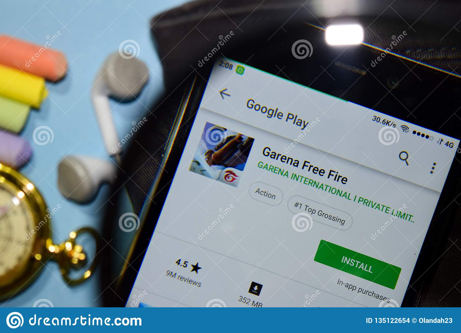Garena Free Fire Dev App With Magnifying On Smartphone