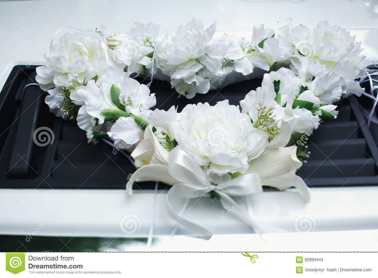 The garland of white flowers lies on the car stock photo image of download the garland of white flowers lies on the car stock photo image of elegance mightylinksfo