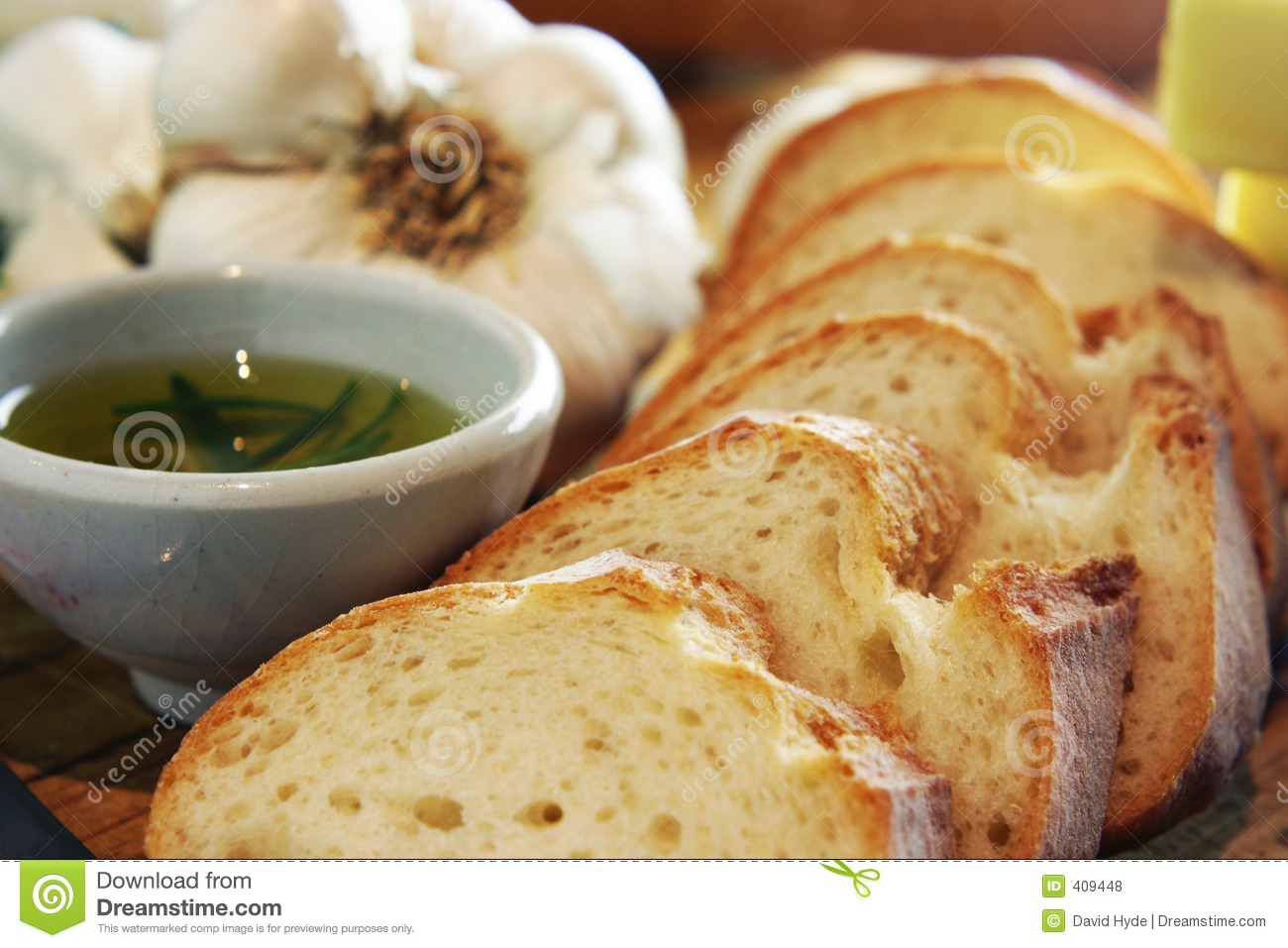 ... shot of garlic bread preparation. Includes rosemary infused olive oil