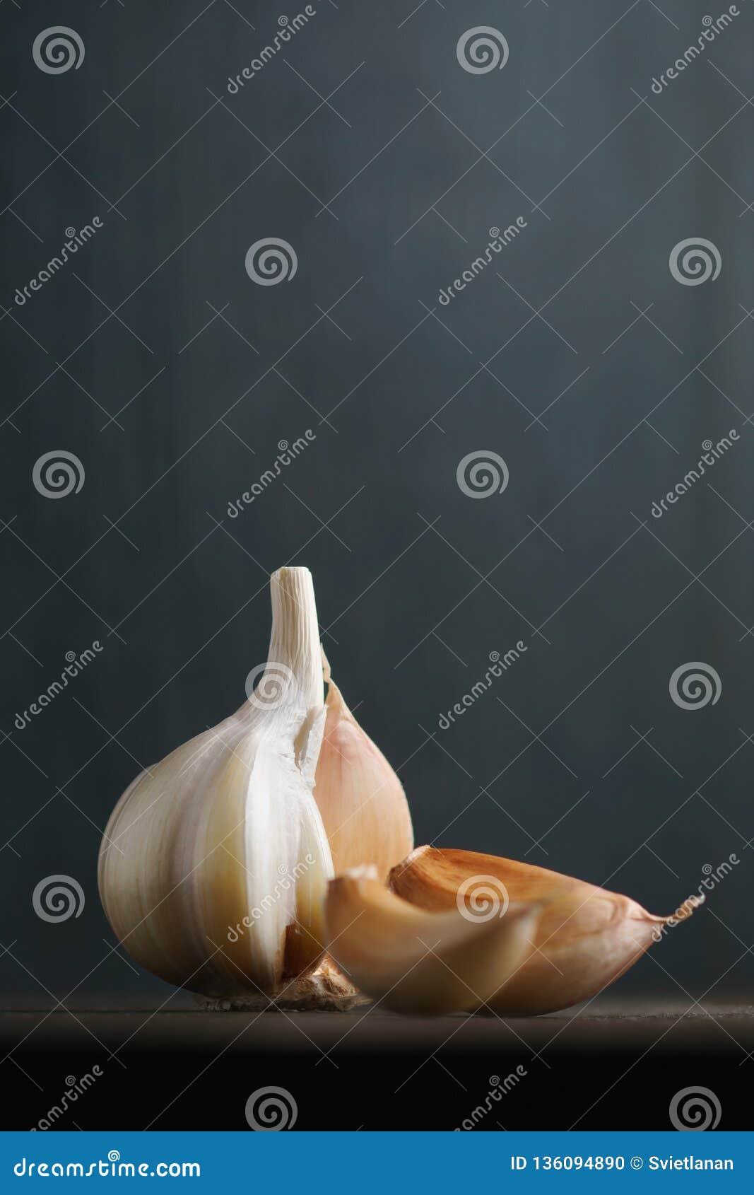 Garlic and garlic cloves on dark