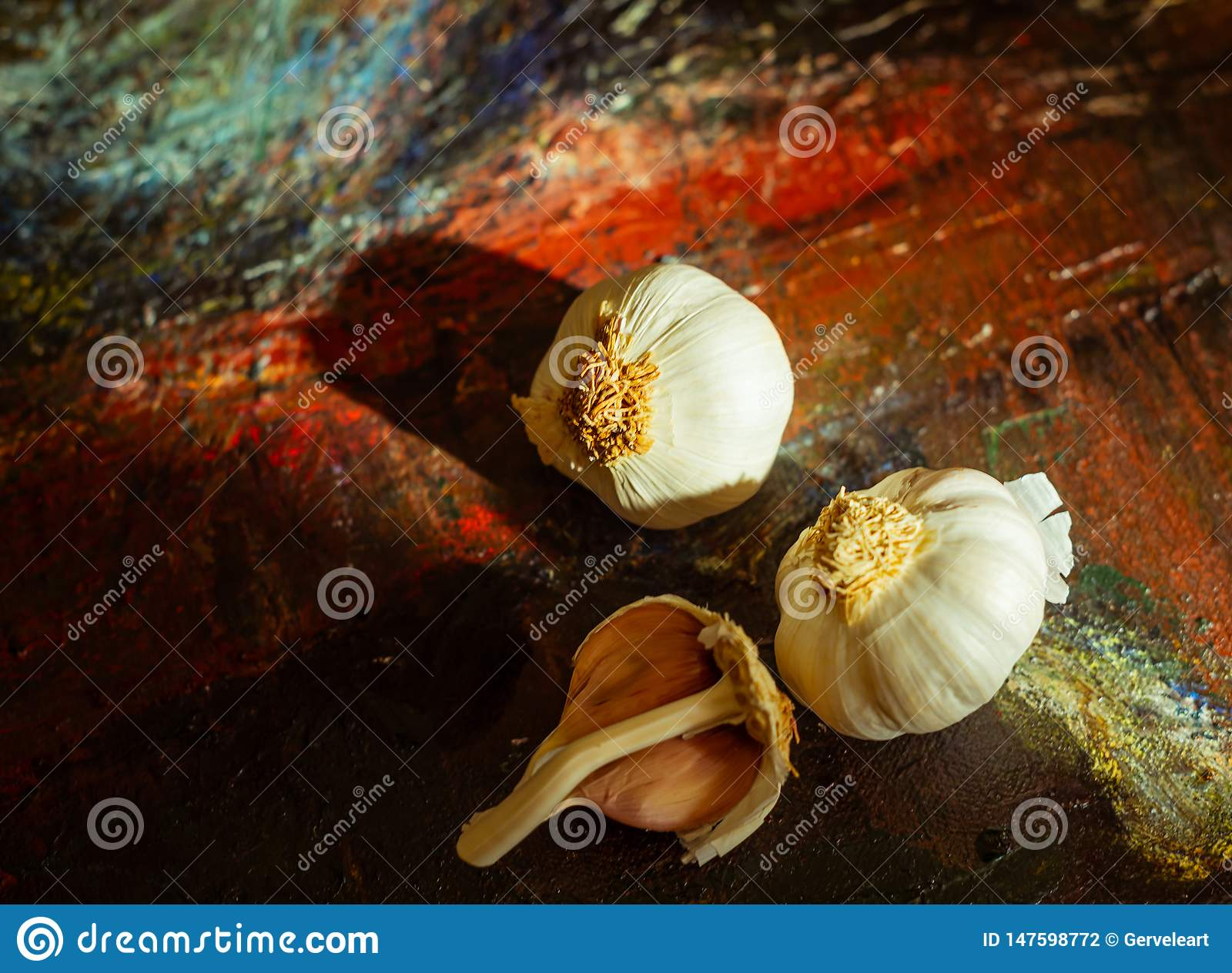 Garlic on colorful canvas background. Close Up