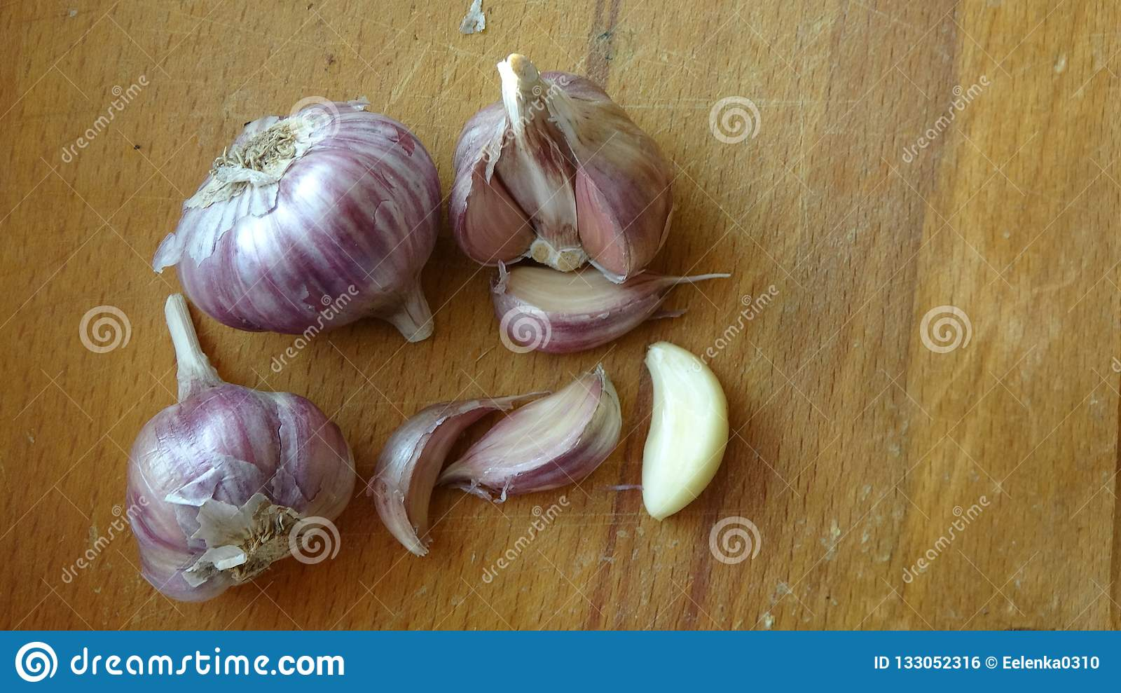 Heads Of Garlic On A Wooden Board Lie On The Table  Whole Bulb Of