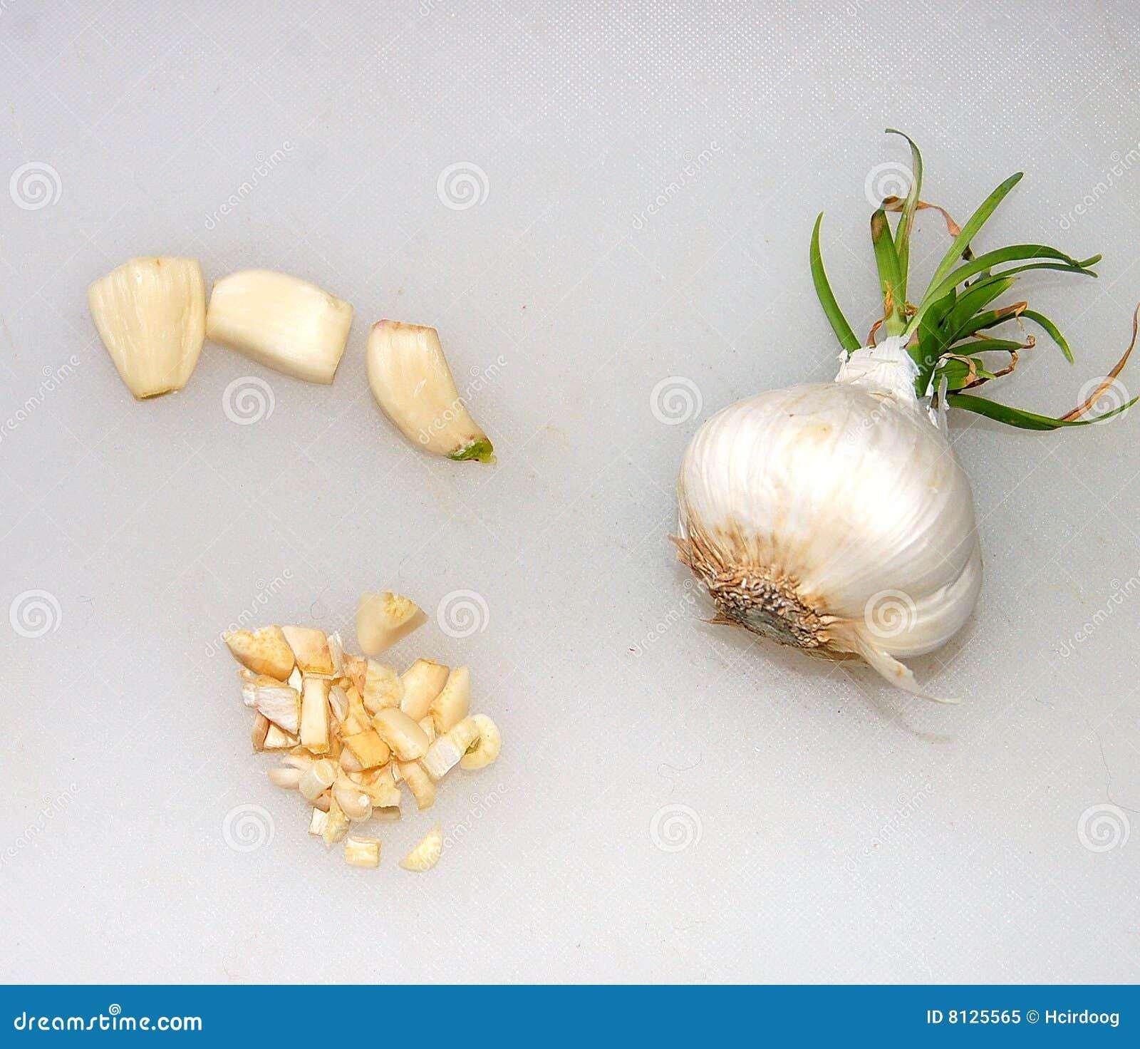 Garlic pieces and garlic bulb