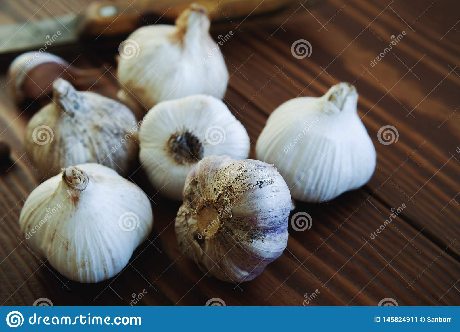 Garlic and spices on a wooden table. Cooking with garlic. Strengthening of immunity