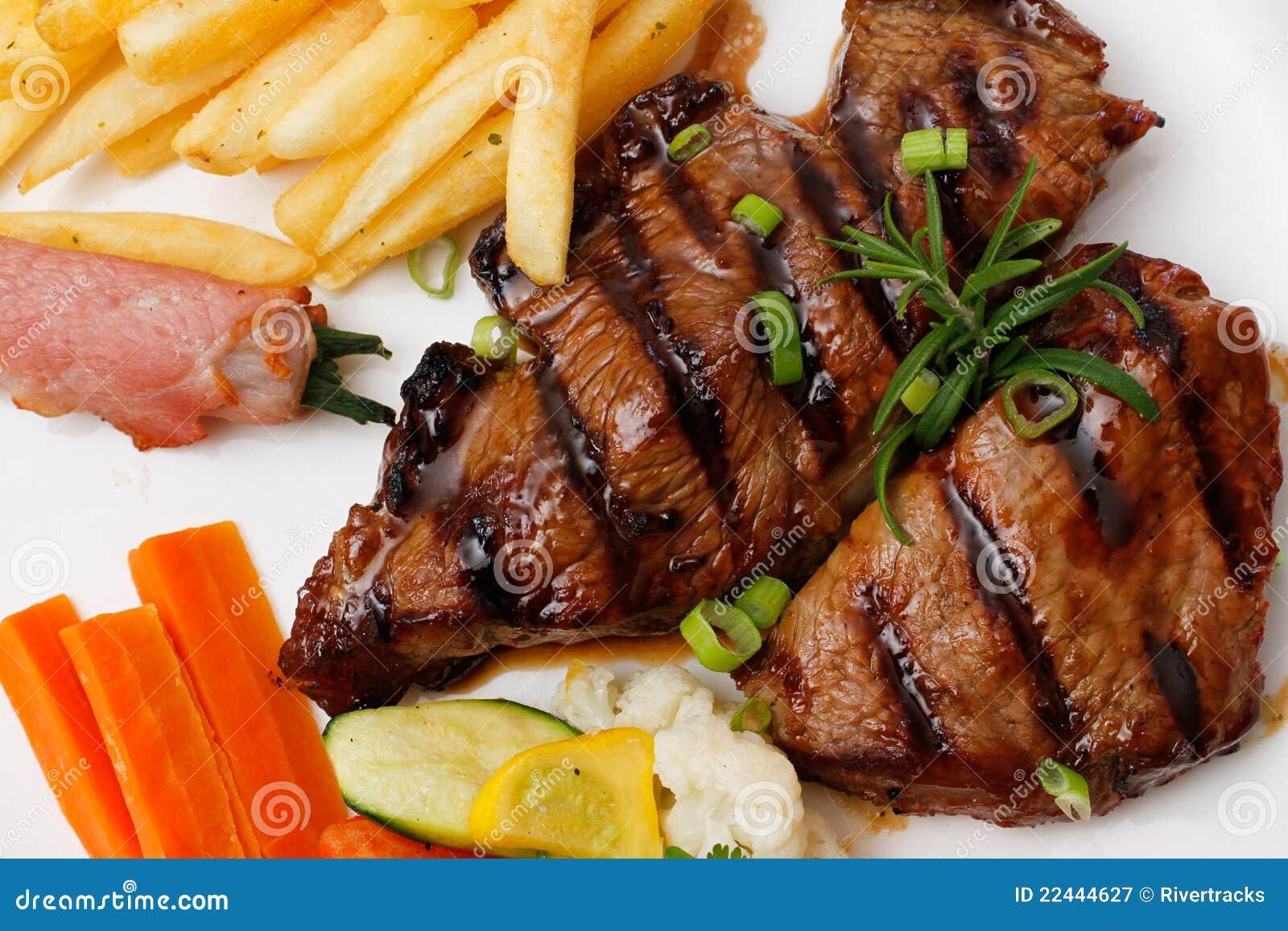 Garnished Plate Of Grilled Steak Meat Stock Image - Image ...