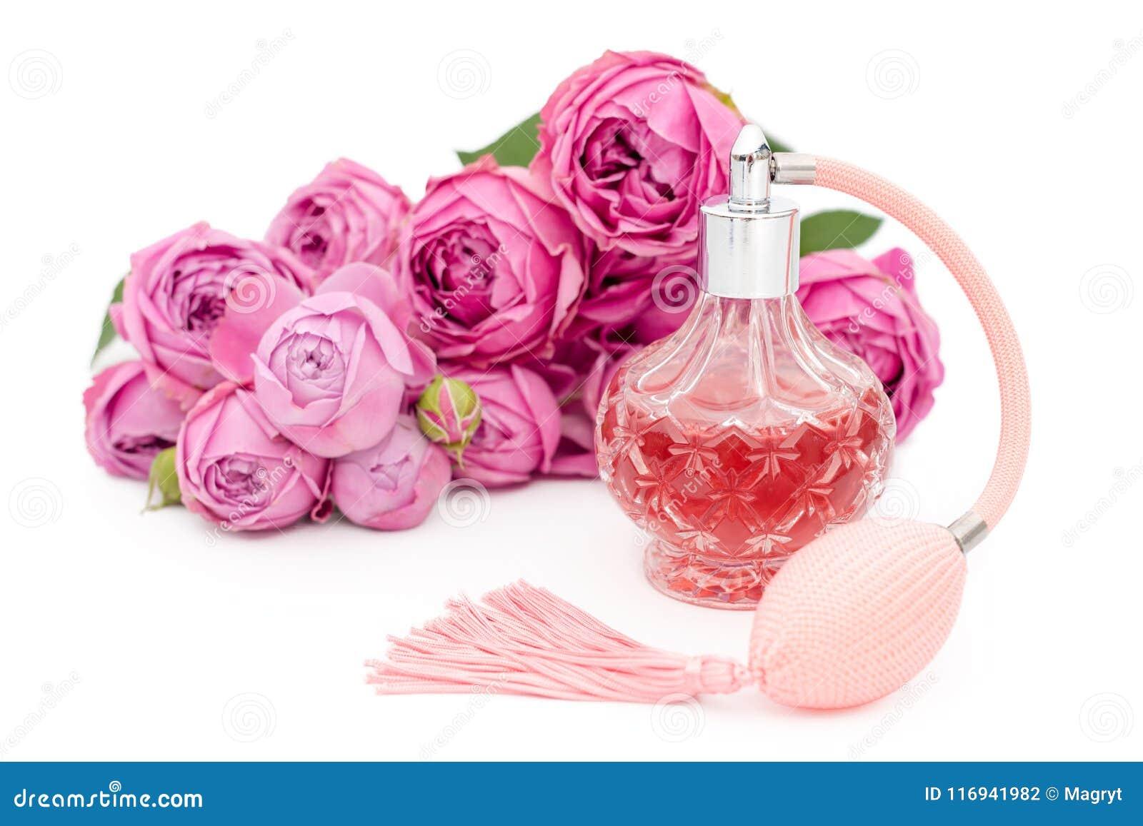 a63b7f7b38e7 Garrafa de perfume com as flores no fundo branco Perfumaria, cosméticos,  coleção da fragrância