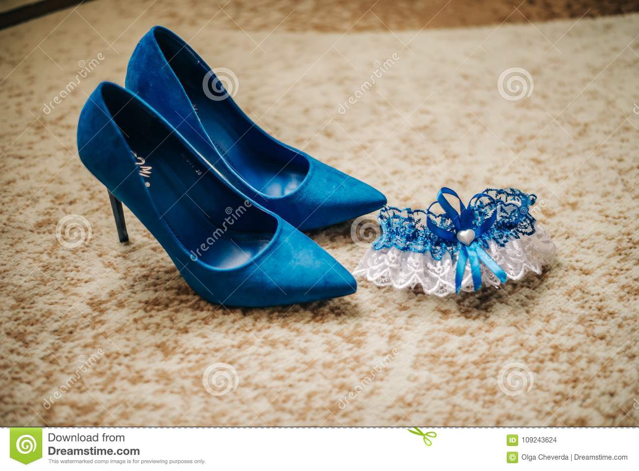 Garter of a bride and high-heeled shoes