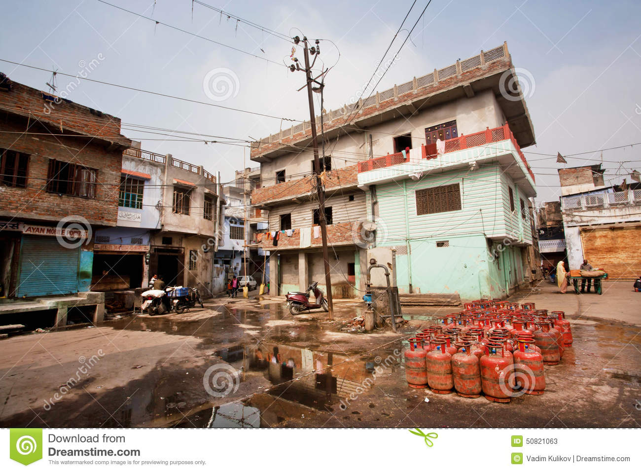 Gas Cylinders Put On A Dirty Street With Old Houses Of