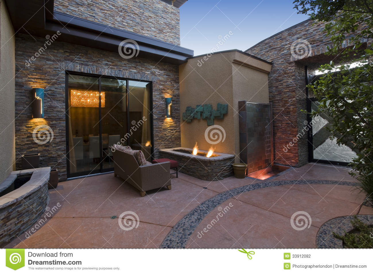 Gas Fire Pit And Sofa In Courtyard