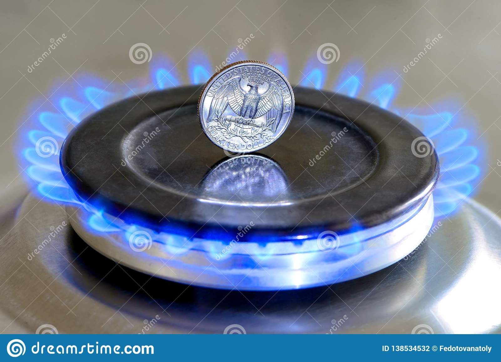 Gas hob with burning natural gas, quarter US dollar coin