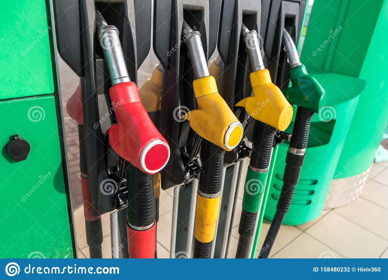 Gas And Petrol Station  Guns For Refueling At A Gas