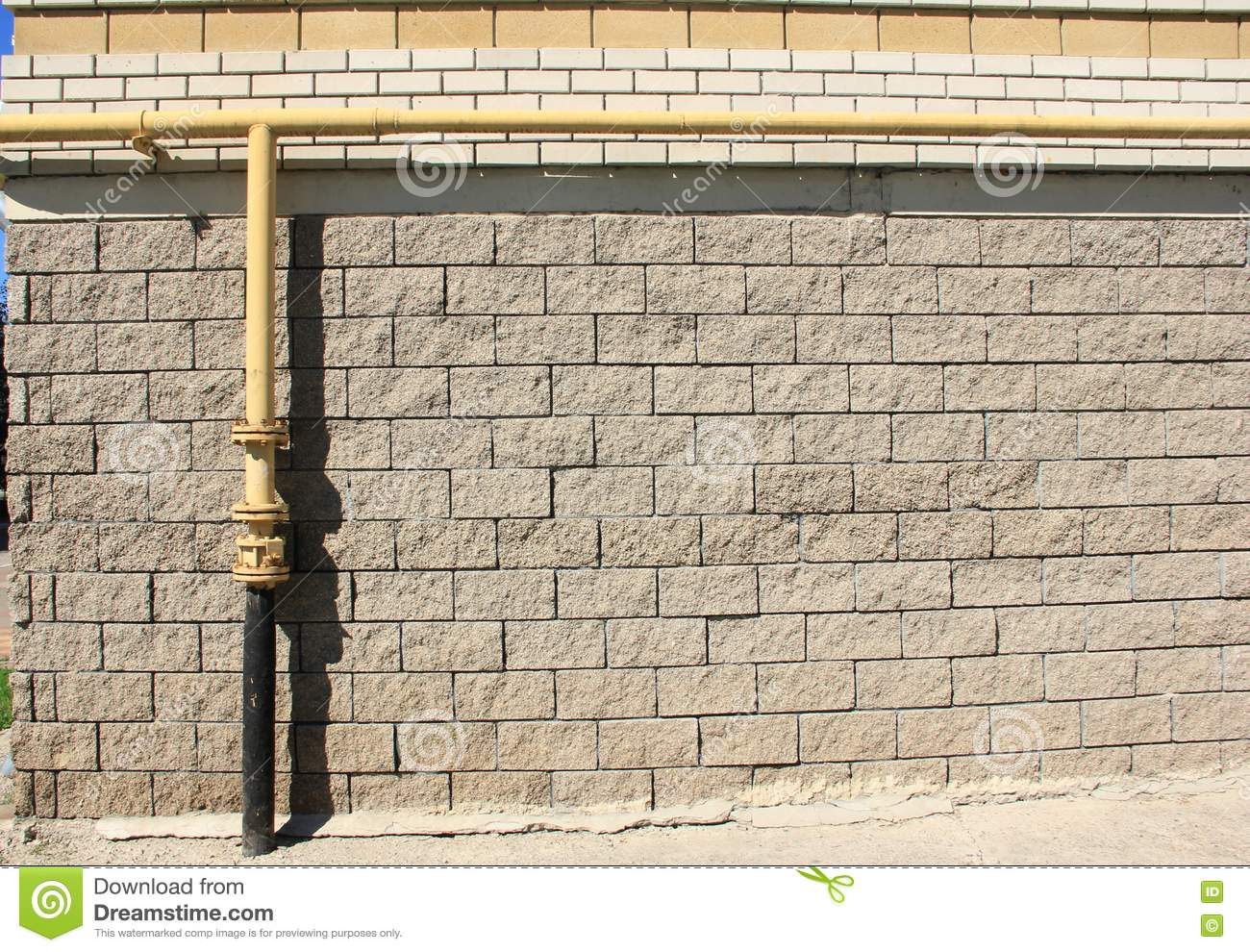 Gas pipe on a brick wall