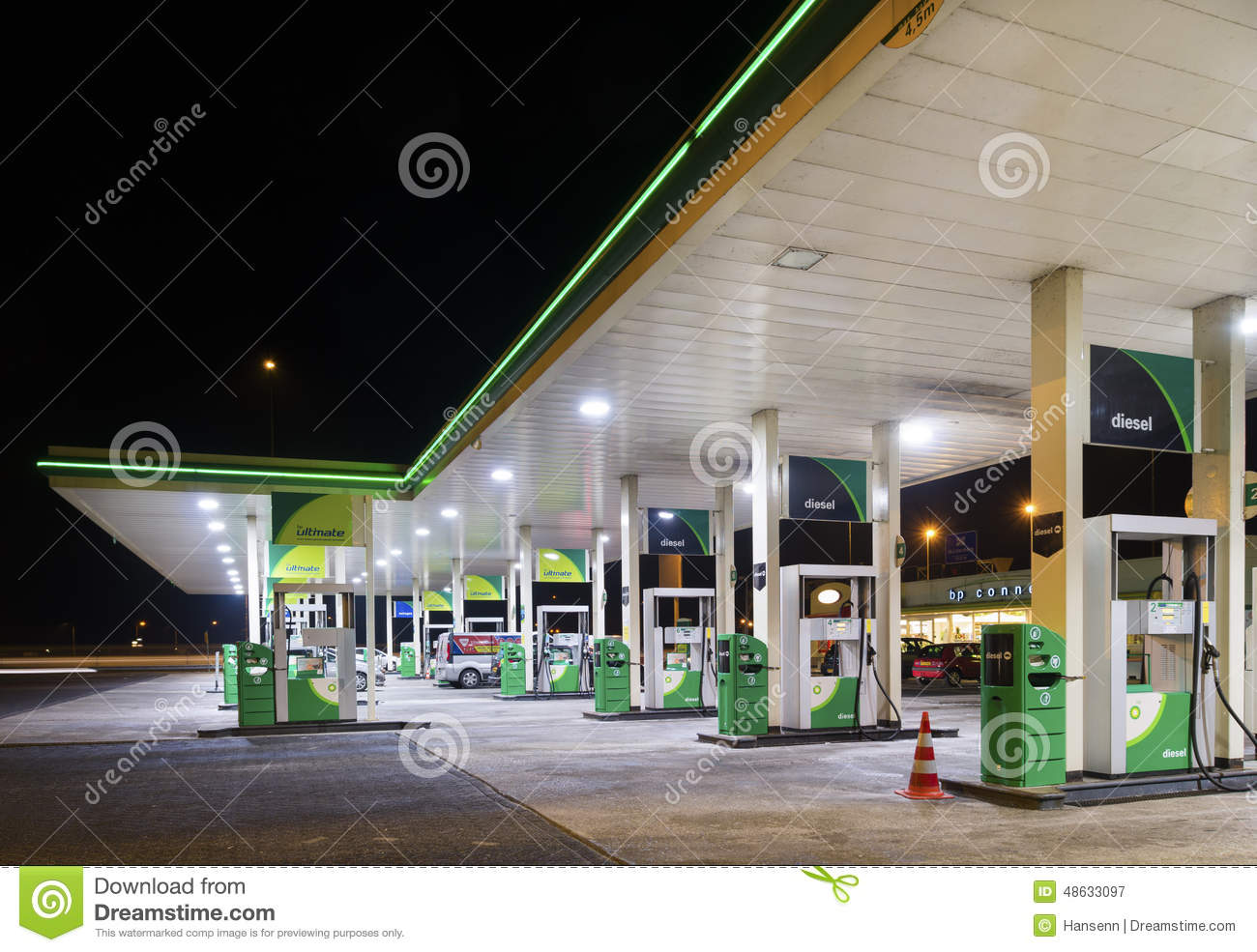 Gas station at night editorial photography  Image of premium