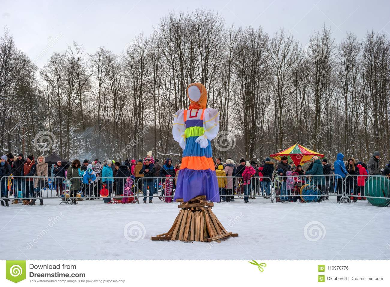 Gatchina, Russia - February 18, 2018: Shrovetide feast. Maslenitsa. A large doll is ready for burning. The spectators
