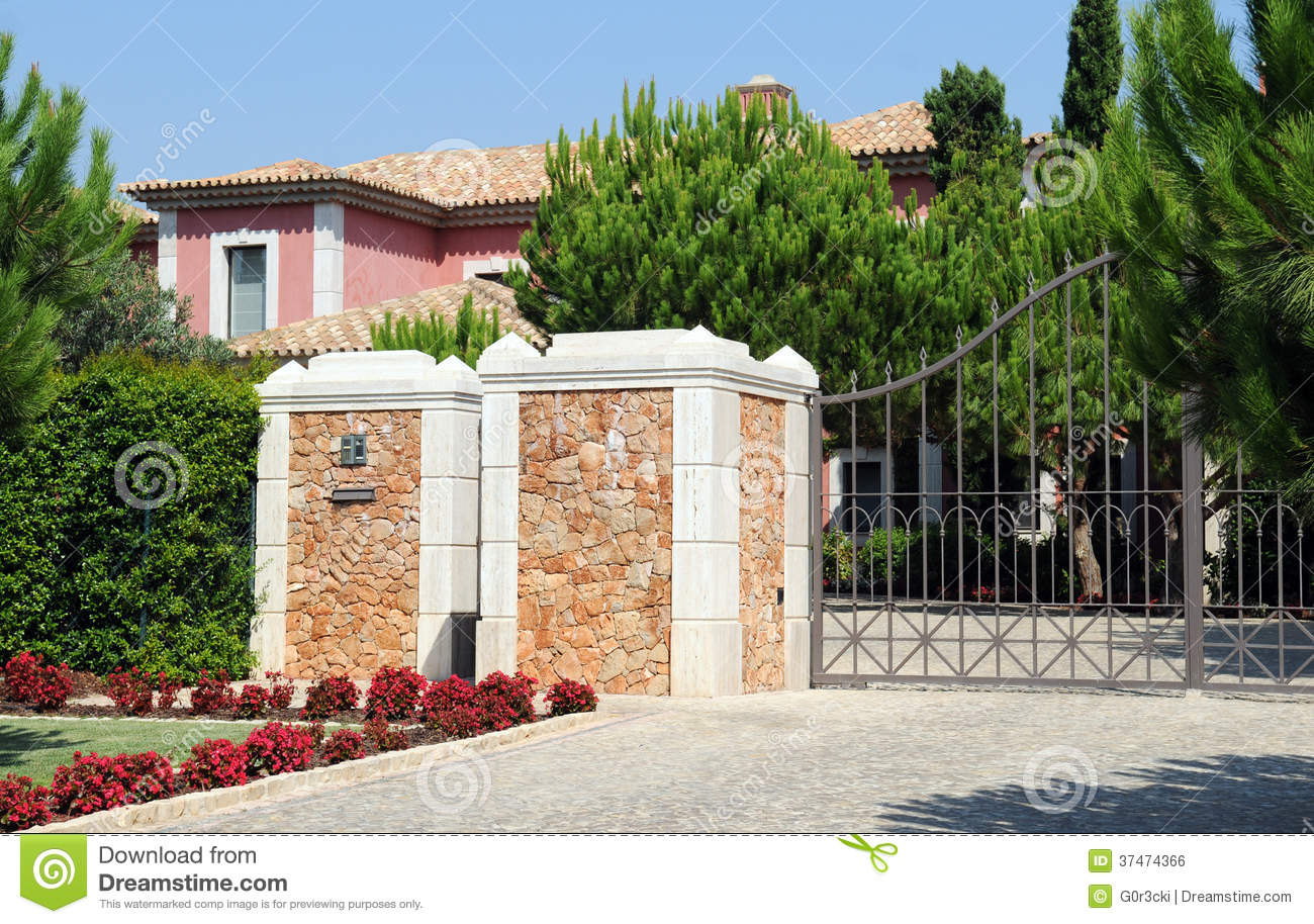 Front Gate From A Big Pink Residence Royalty Free Stock