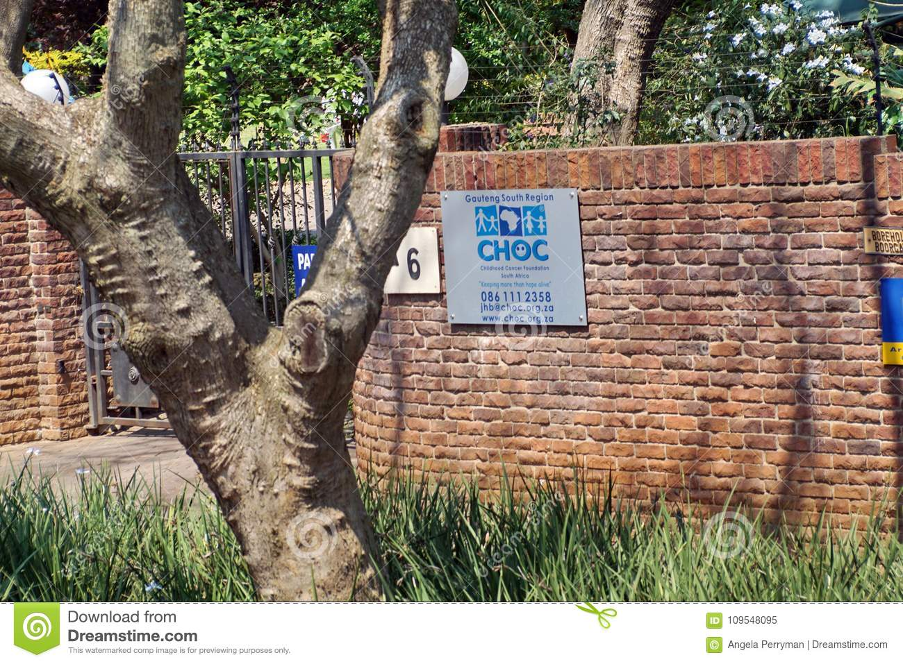 Gate in a brick wall for the compound of a childrens cancer charity in johannesburg south africa