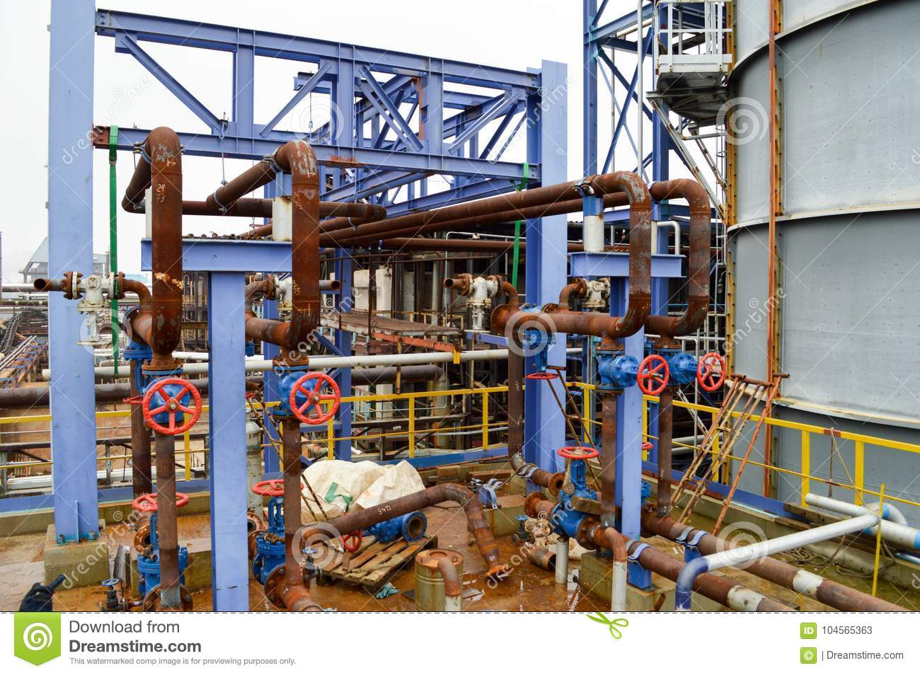 Gates, rusted pipe fittings in petrochemical production.