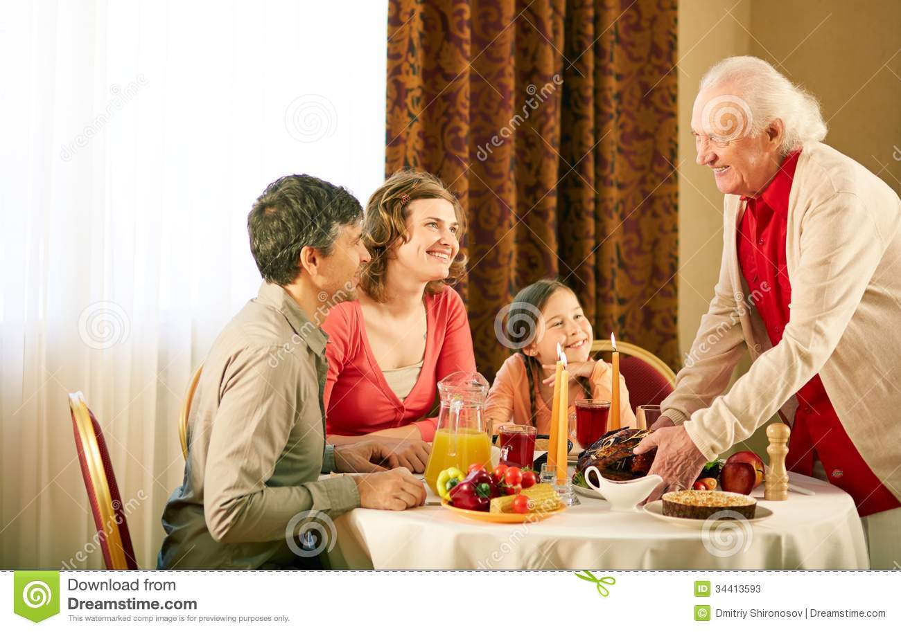 gathered at dinner table stock photos