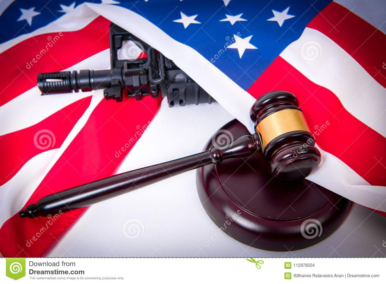 Gavel with gun on background of USA flag.