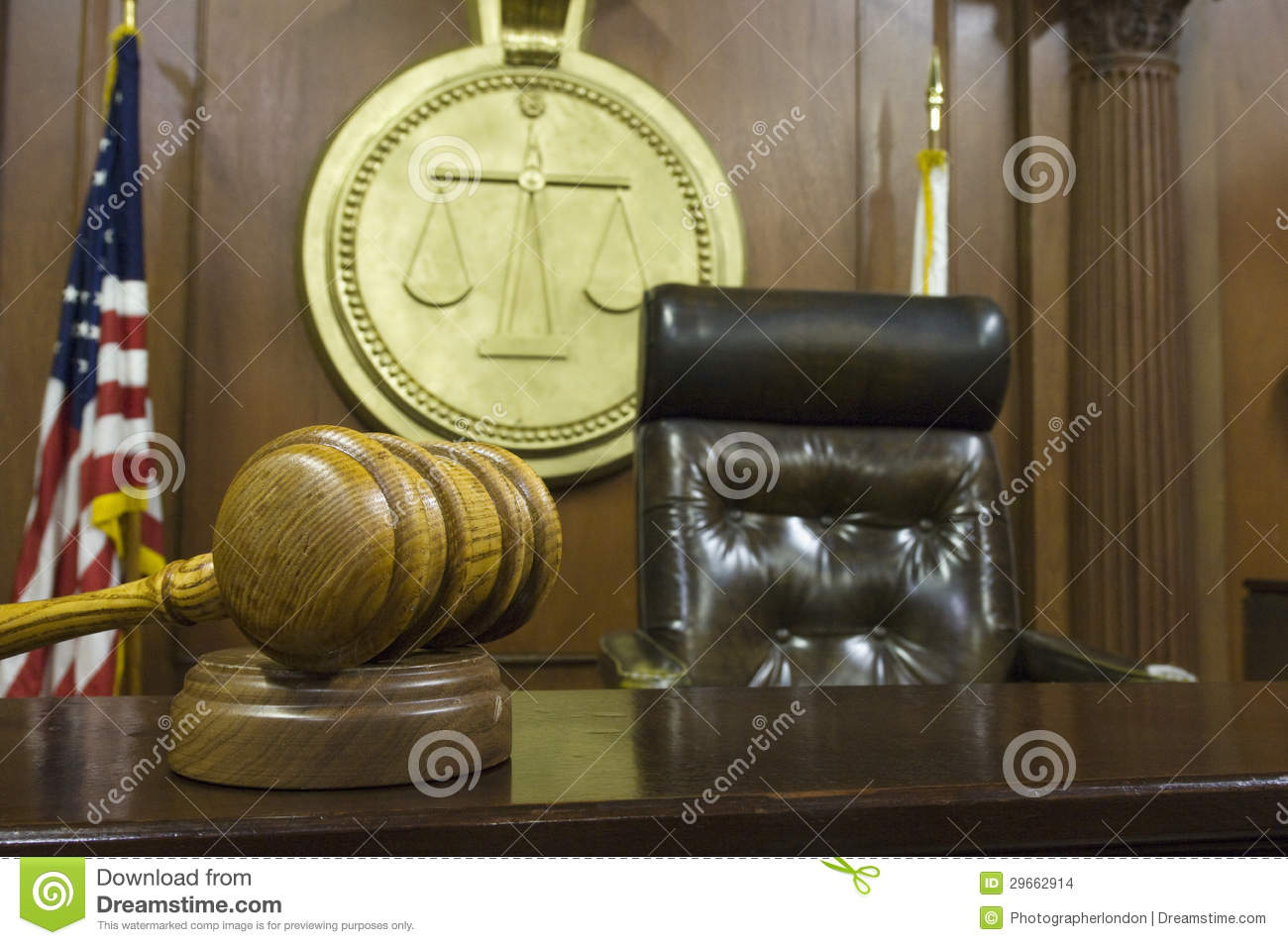 ... of gavel and wooden block on table with judge's chair in courtroom