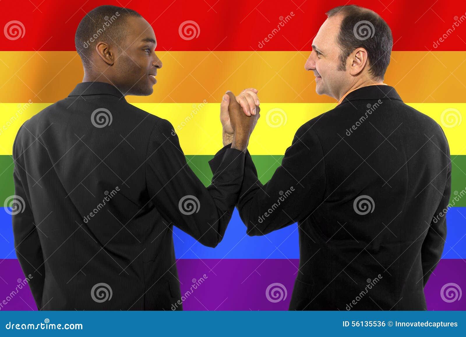 Same- sex homosexual couple with a rainbow gay pride flag