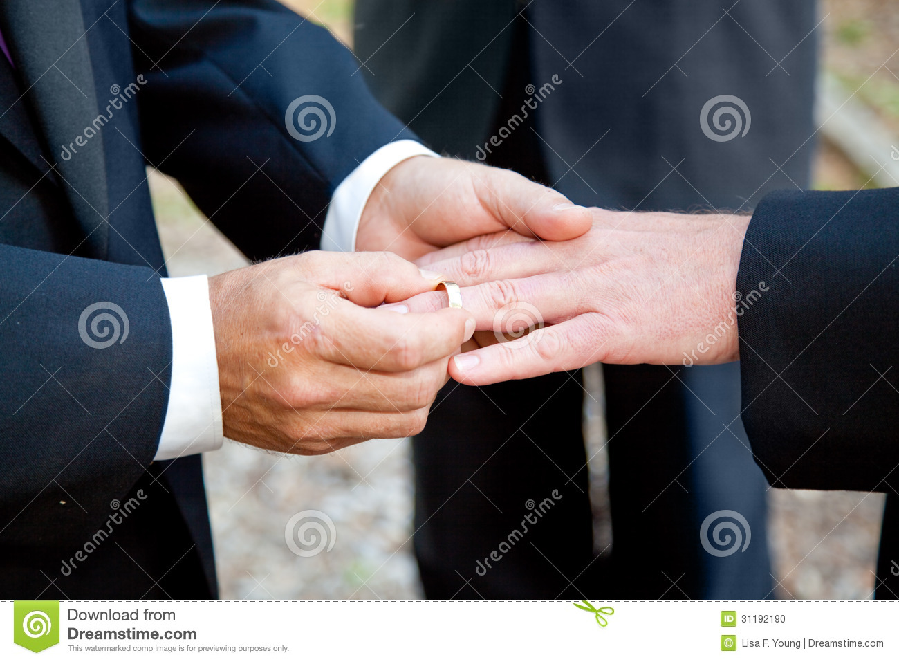 stock photography gay couple holding hands wedding rings image gay wedding bands Gay Wedding Exchanging Rings Stock Photo