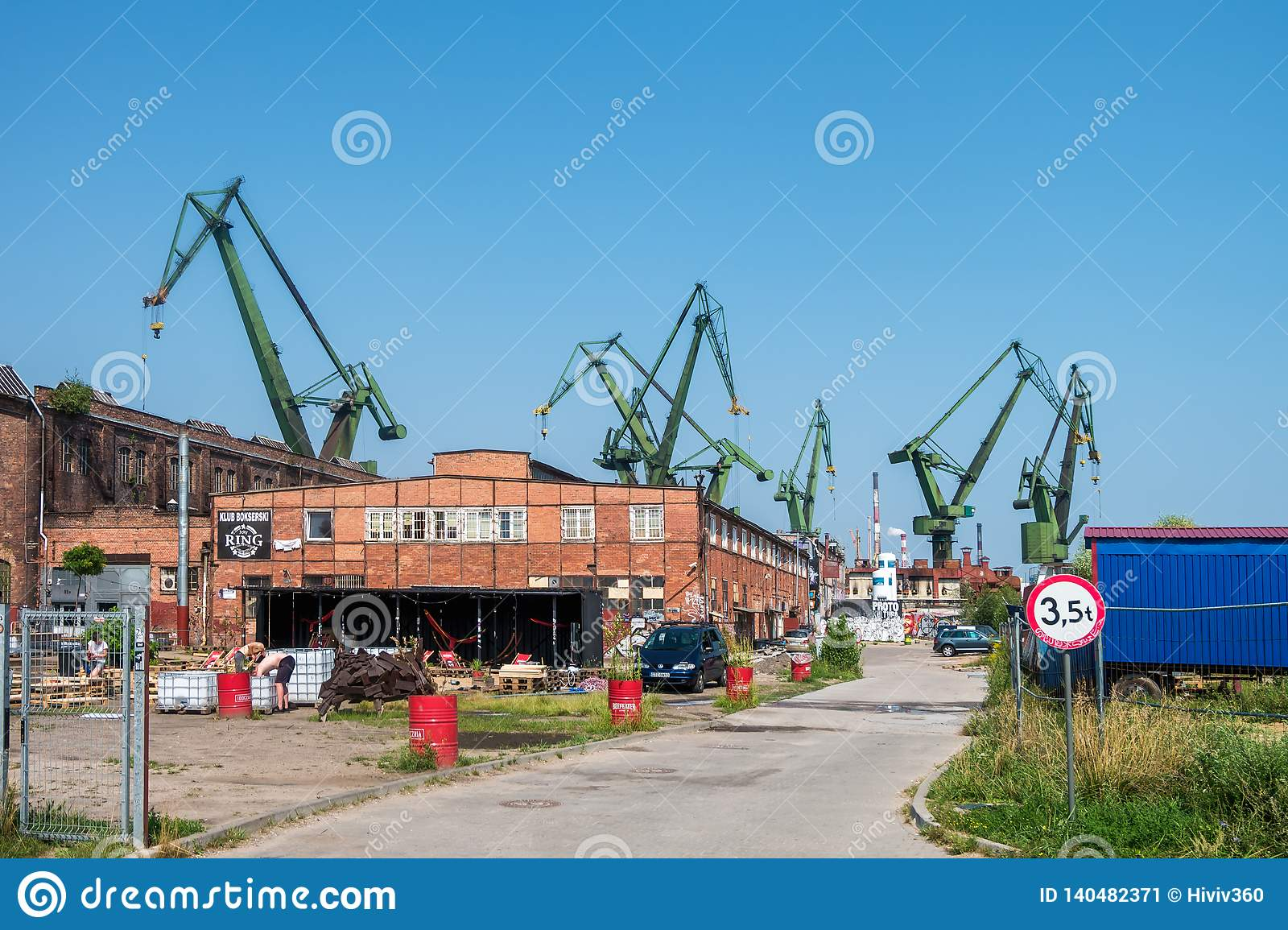 GDANSK, POLAND - AUGUST, 2018 : Gdansk Shipyard by Vistula river, the birthplace of polish Solidarity/ A view of shipyard and the
