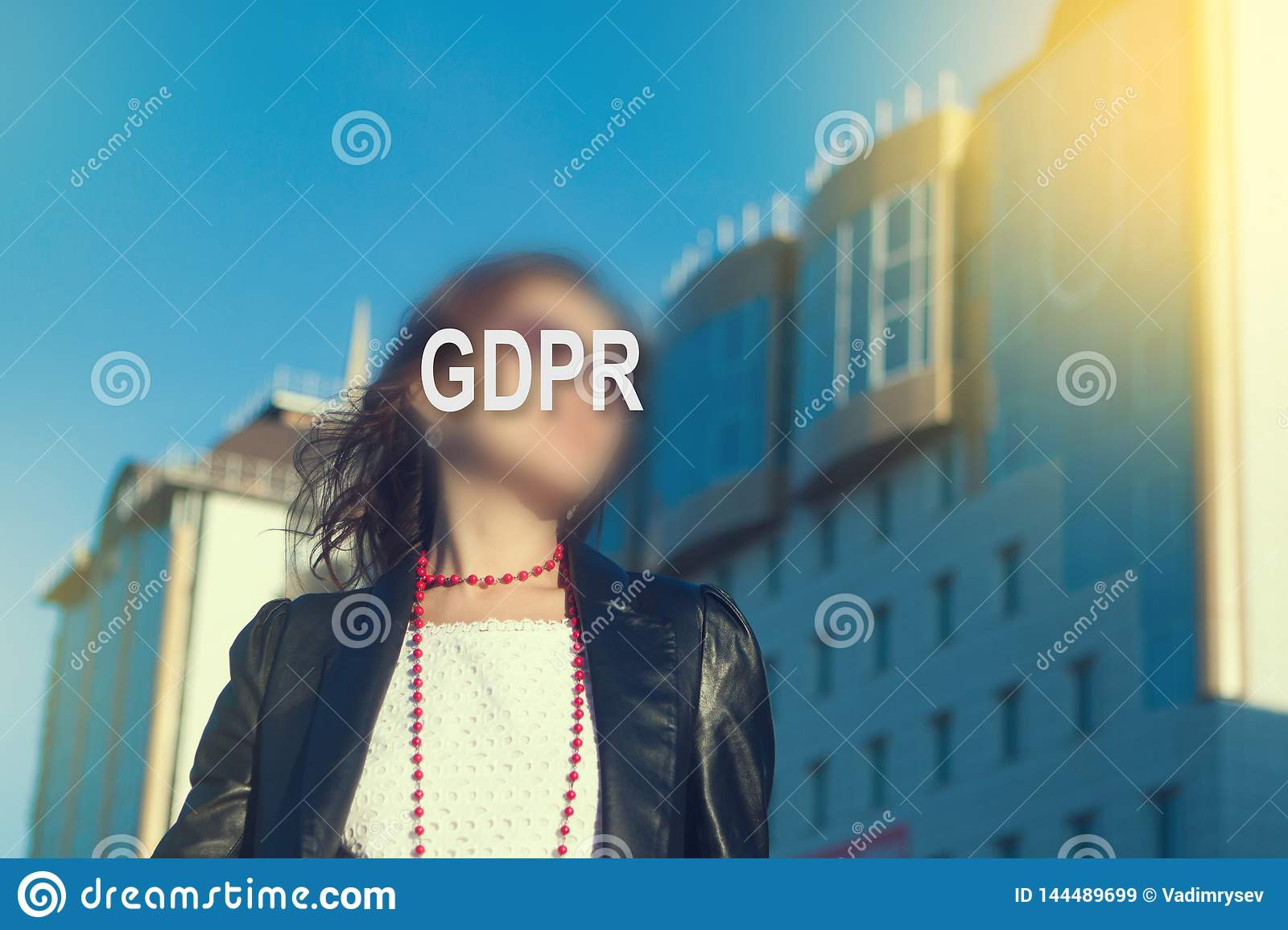 GDPR - woman hiding her face with an inscription GDPR.