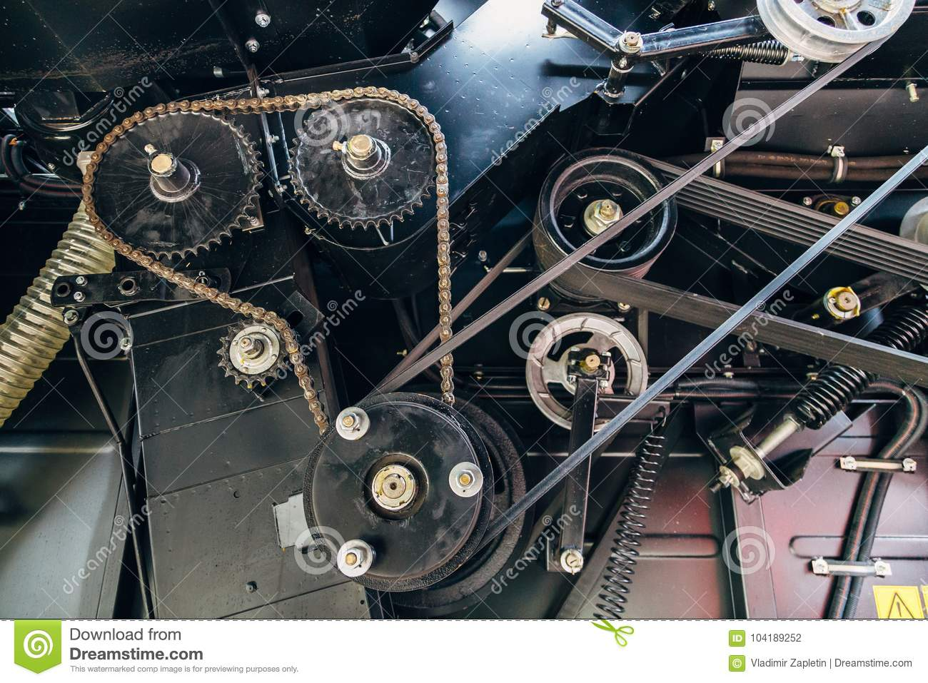 gears with chain drive  pulleys with drive belts  industrial mechanical background stock photo