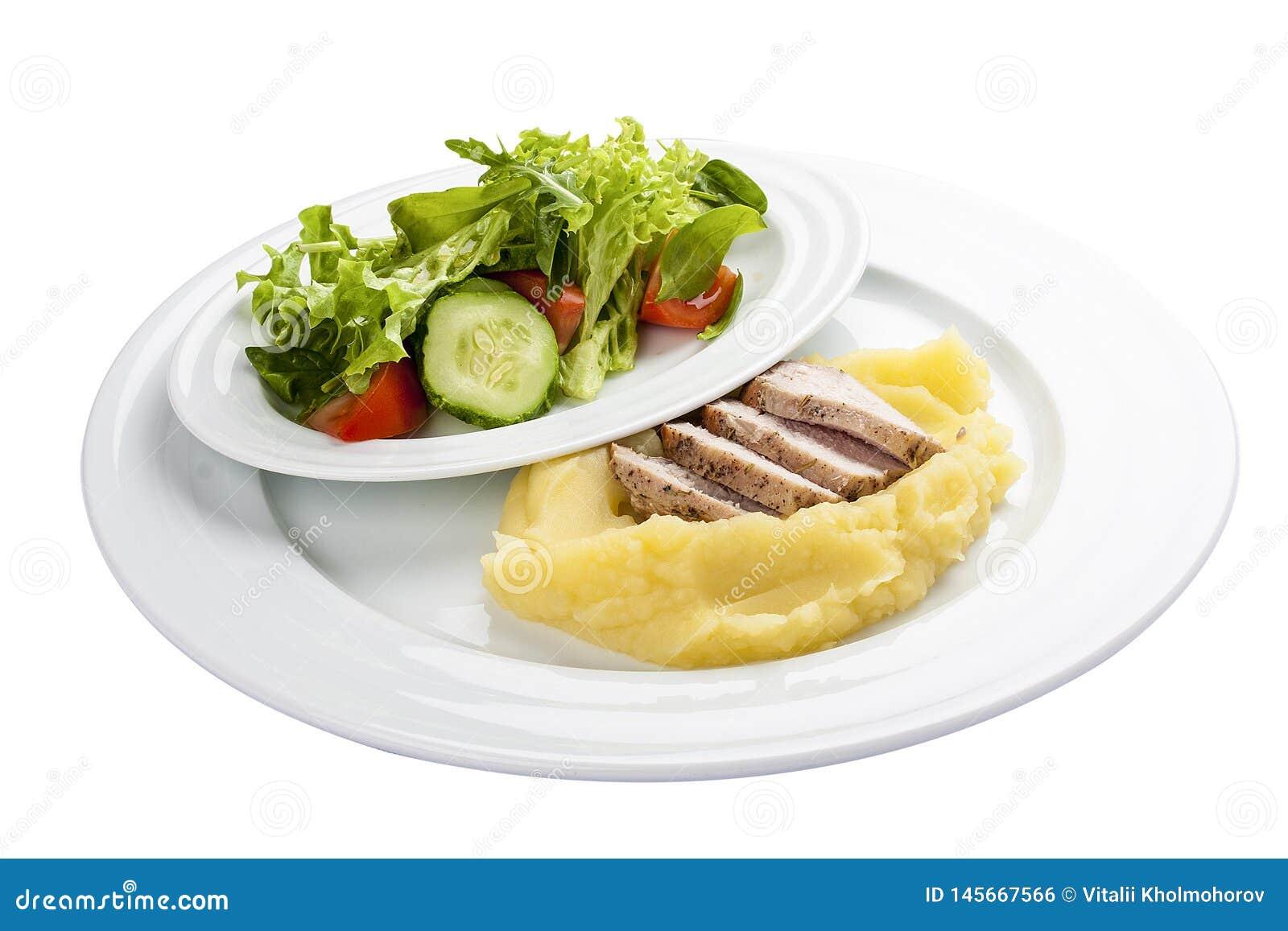 Gebakken varkensvlees met fijngestampte aardappels