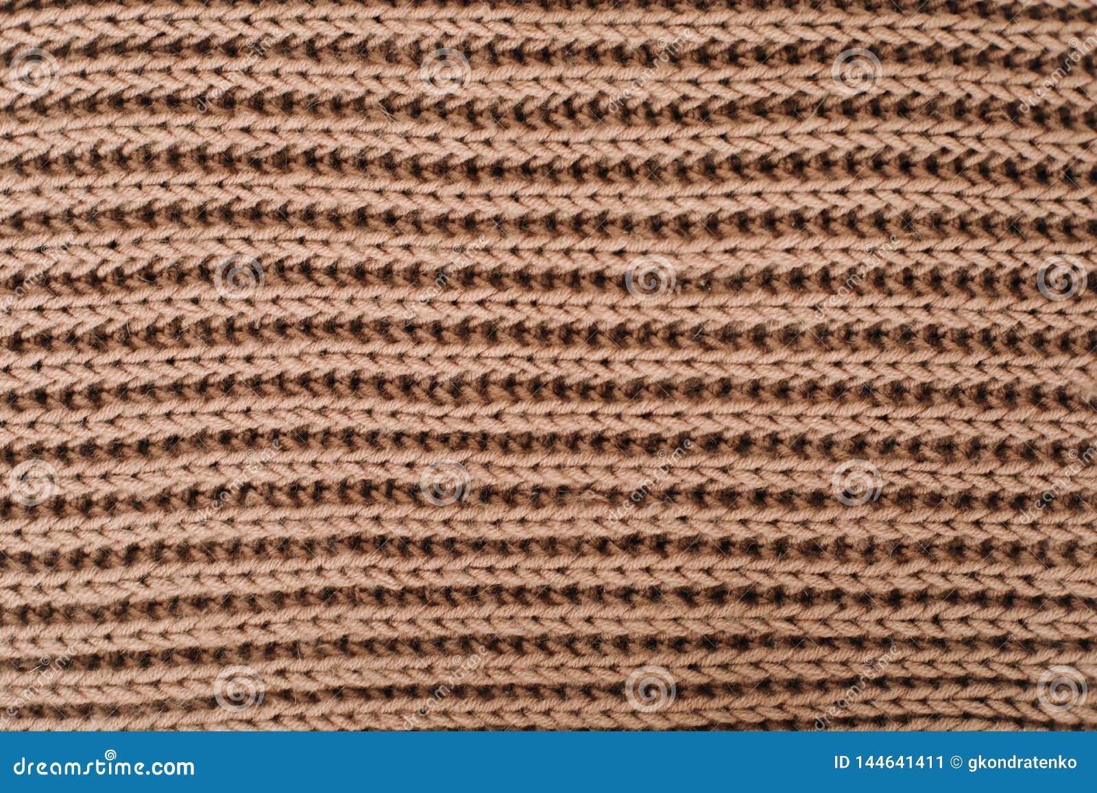 Gebreide achtergrond breiend patroon van wol knitting Textuur van gebreide wollen stof voor behang en een abstracte achtergrond