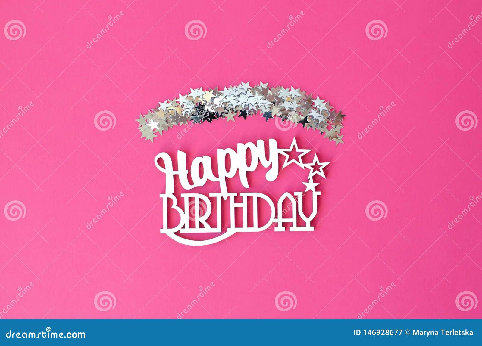 Geburtstagsebene auf einem rosa Hintergrund mit funkelnden Sternen