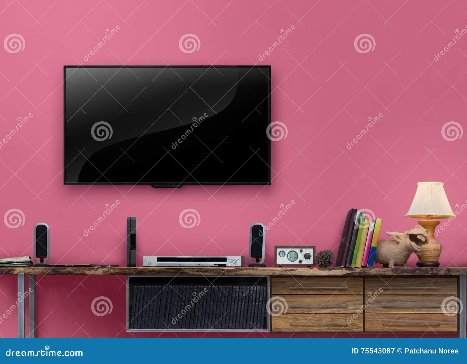 Geführter Fernsehholztisch Mit Rosa Wand Im Wohnzimmer Stockbild ...