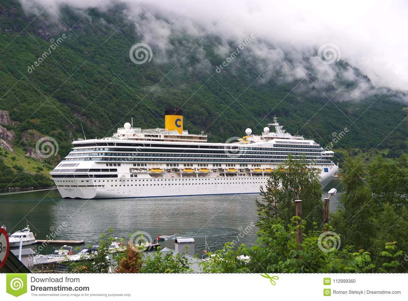 Geiranger, Norway - January 25, 2010: cruise ship in norwegian fjord. Travel destination, tourism. Adventure, discovery, journey.